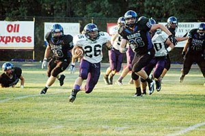 Junior running back Jordan Harris (26) ran 13 times for 101 yards and three touchdowns in Glen Este's season-opening win over West Clermont rival Amelia.