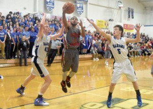 Goshen's Deonte Bailey drives toward the hoop in the Warriors' victory over Amelia on Friday, Feb. 3, 2017.